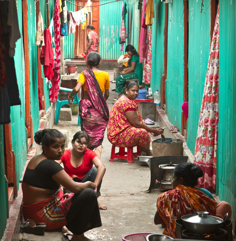 Sex workers cooking and washing cloth in their living and working area.