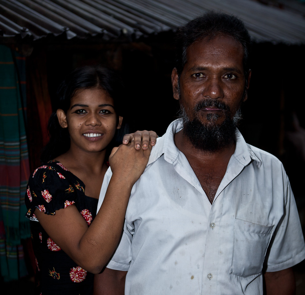 A sex worker and her pimp in a brothel in a city in Bangladesh.