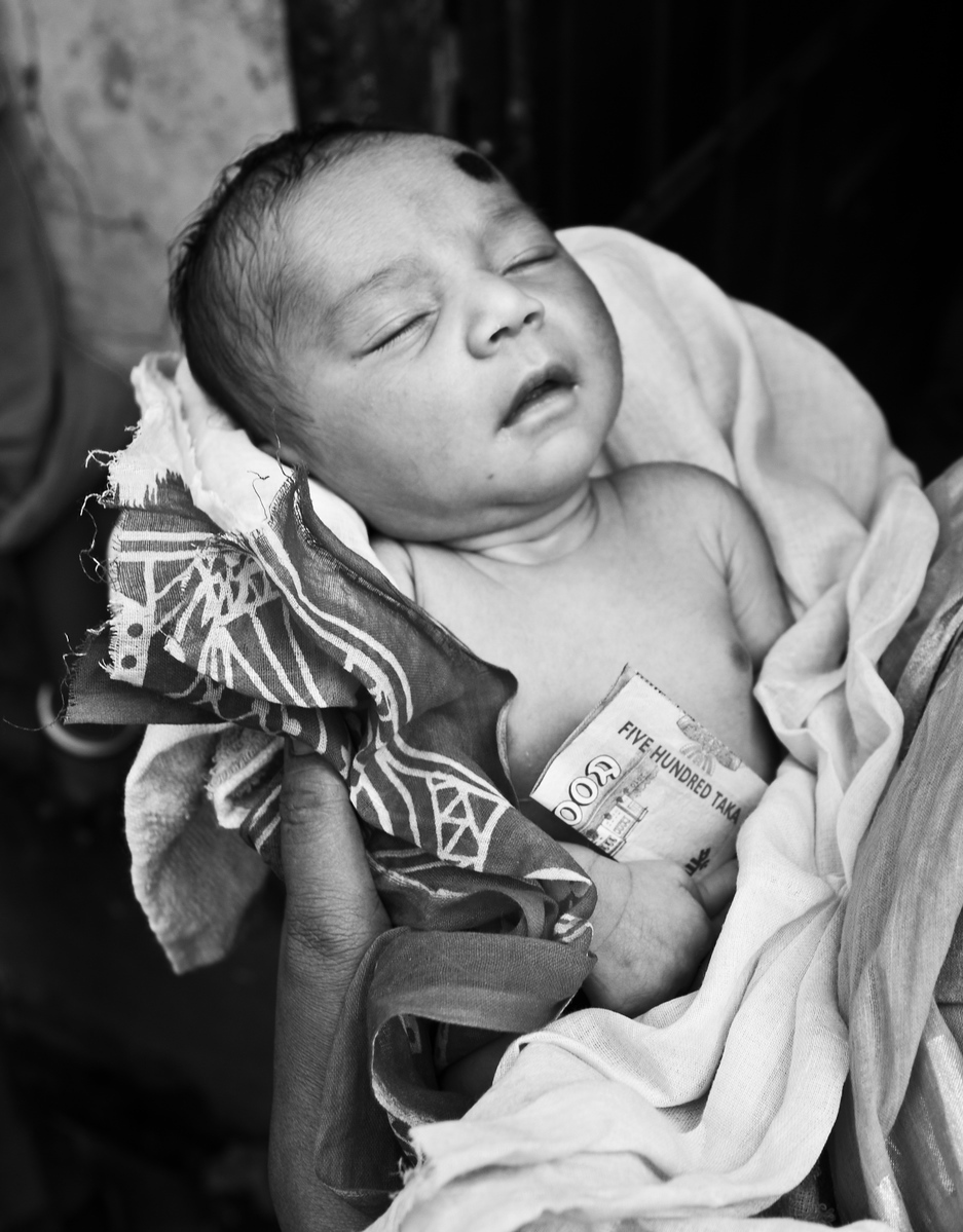A 20 days old baby, who has been born in a brothel in Bangladesh. His mother and grand mother are sex workers.