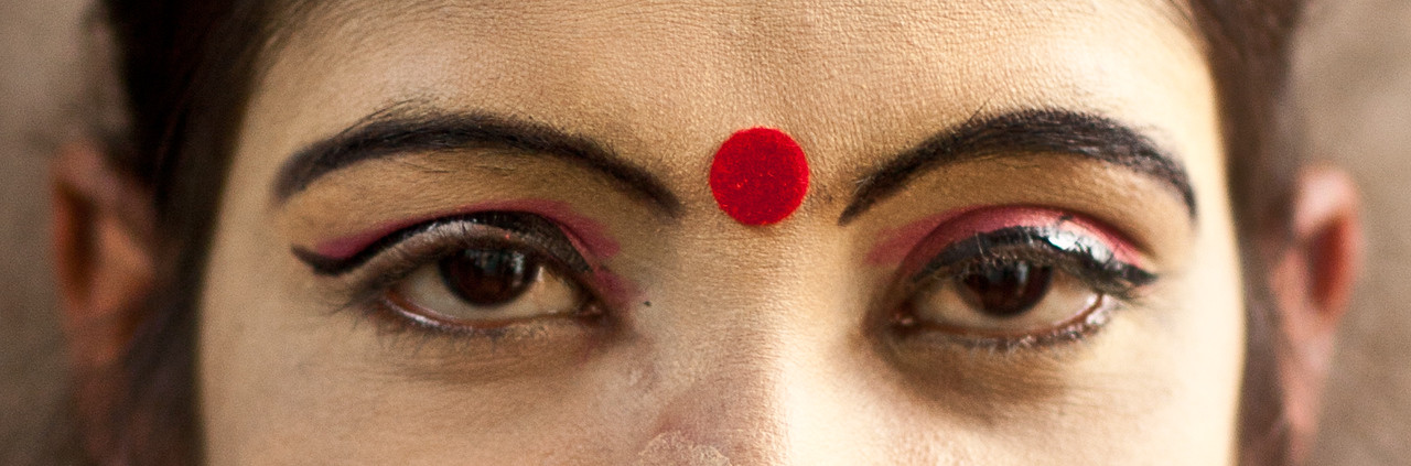 Woman with the red bindi.