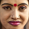 A woman with purple lips - she lives and works in a brothel in a city in Bangladesh.